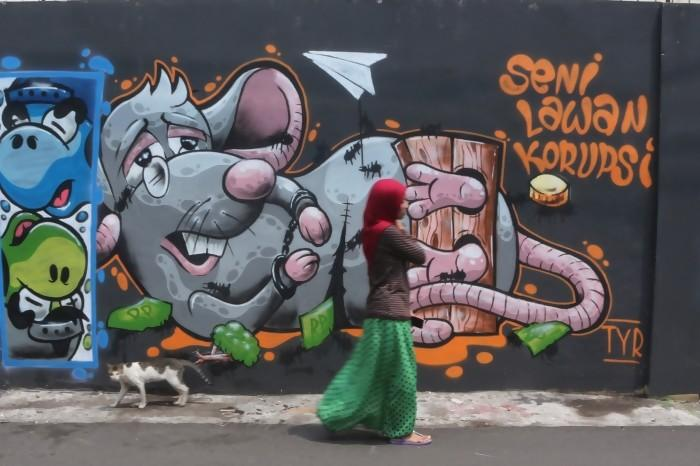 Mural seni lawan korupsi. Sumber foto M Ali Wafa, rimanews.com